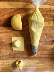 Tortelli di patate su fonduta di Taleggio